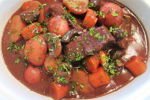 Hearty Slow Cooker Beef Stew With Red Wine - An easy, dressed down version of the classic French Boeuf Bourguignon, we are loading this beef stew with carrots, potatoes and mushrooms, and stewing it in a rich red wine and herb sauce. #beefstew #slowcookerrecipes #comfortfood | https://tiger-corporation-us.com