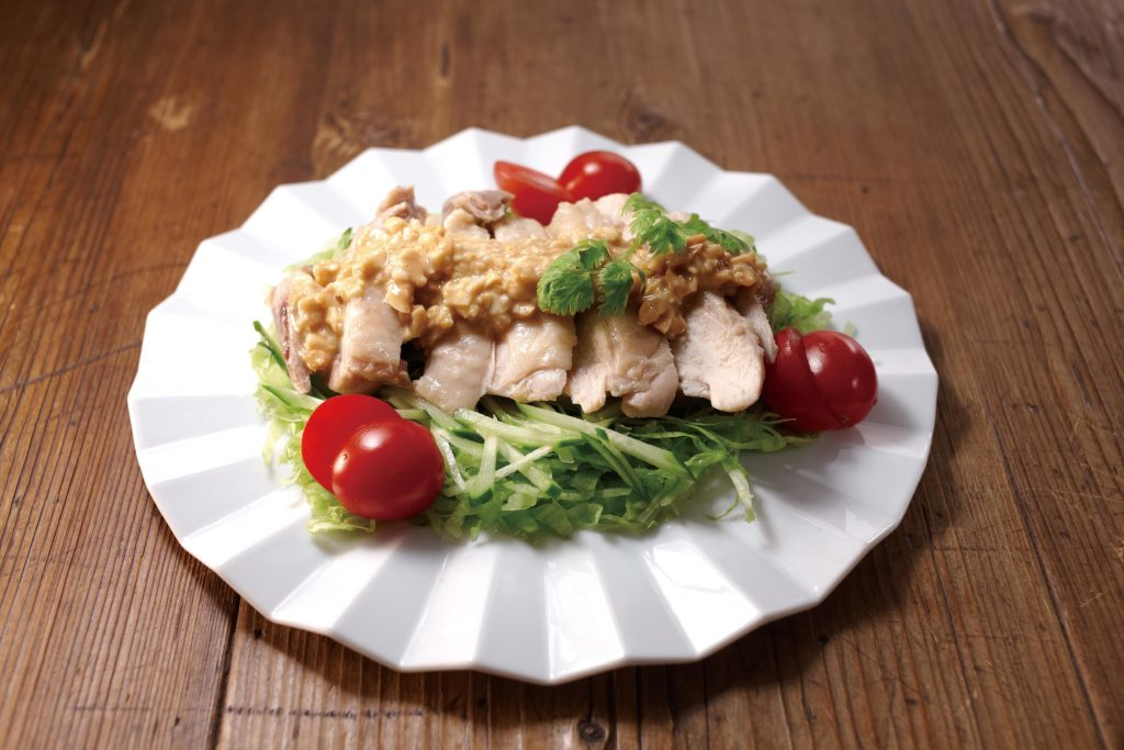 Bang bang chicken is a dish consisting of steamed and sliced chicken served over julienned cucumber - with a savory, nutty, sweet (and sometimes spicy) dressing. #chickenrecipe #japanesefood | Tiger USA