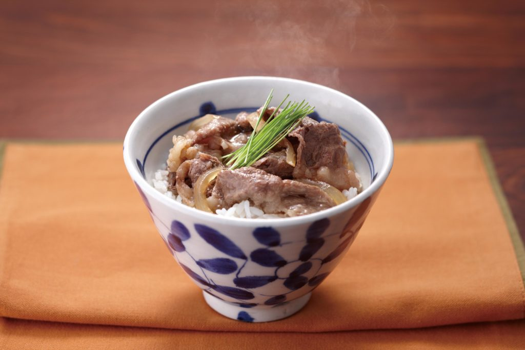 Gyudon Recipe - Gyūdon (牛丼) is a Japanese recipe that consists of thinly sliced beef and onions simmered in a savory and mildly sweet sauce, served over rice. It's Japanese comfort food at its best! Tiger USA recipes
