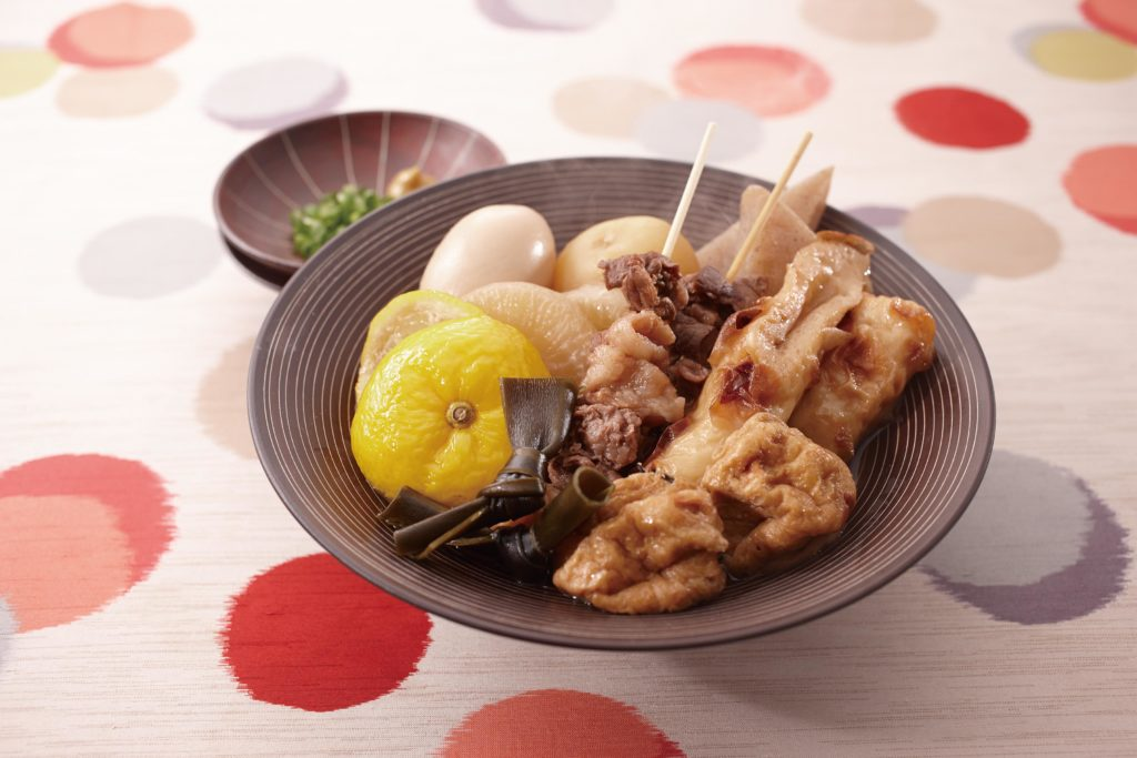 Oden with yuzu essence - a slow simmered Japanese dish that typically contains fish cakes, atsuage (deep fried tofu), fish balls, carrots, daikon, hard boiled eggs and konjac (or konnyaku) - served in a savory and sweet soy sauce and dashi broth. Healthy comfort food for the soul! #winterrecipes #comfortfood #japanesefood | Tiger USA