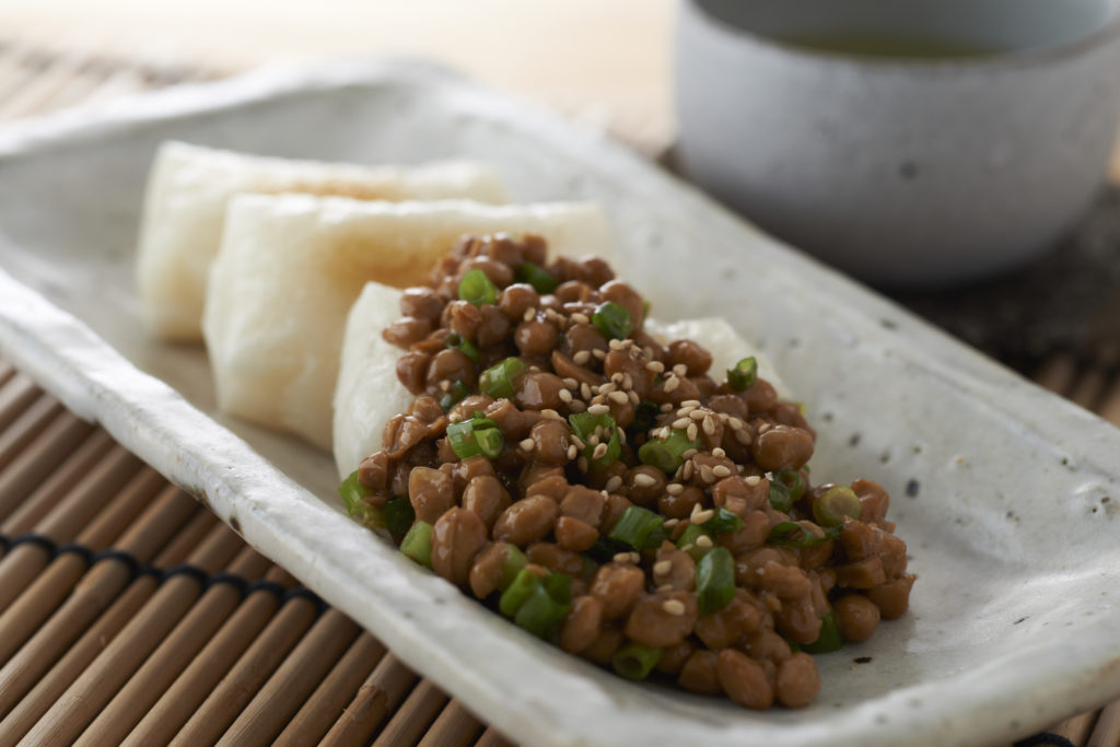 Natto Mochi - Packed with a deep, savory punch of flavor - and a chewy, stretchy texture - this natto mochi recipe is one of those Japanese dishes everyone should try at least once! #japanesefood #ricecakes #japaneserecipes | Tiger USA
