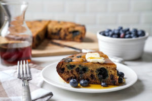 Giant rice cooker pancake slice with blueberries and syrup